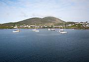 Yachts moored in the harbour at Castlebay, Barra, Outer Hebrides, Scotland, UK
