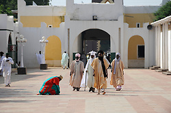 Sept. 23, 2010 - Kano, Nigeria - Devout subjects visit the 15th century palace of The Emir of Kano, His Royal Highness Alhaji Dr. Ado Bayero, (not in picture). The Emir supported the polio vaccine ban but now supports the immunization campaigns. Religious zealotry and misinformation have coerced villagers in the Muslim north of Nigeria into refusing polio vaccinations and led to the reemergence of polio only a few years after it nearly joined smallpox on the CDC's list of eradicated diseases. The polio vaccine was banned in northern Nigeria in the summer of 2003 due to claims by clerics and politicians that the vaccines were tainted and were a Western ploy to spread HIV and make the Muslim girls sterile. During the one year ban, over 3000 children were crippled by polio and over 20 countries re-infected with the Nigeria strain of the virus. (Credit Image: © Mary F. Calvert/ZUMAPRESS.com)