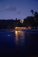 divers entering the water for a night dive at Anse Chastanet Resort, St. Lucia