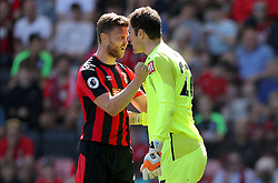 AFC Bournemouth goalkeeper Asmir Begovic and Simon Francis (left) clash during the Premier League match at the Vitality Stadium, Bournemouth.