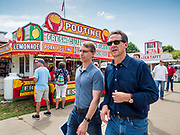 08 AUGUST 2019 - DES MOINES, IOWA: STEVE BULLOCK, right, the Democratic Governor of Montana, walks through the Iowa State Fair. Gov. Bullock, his wife, Lisa Bullock, and their children went to the Iowa State Fair Thursday. Gov. Bullock spoke at the Des Moines Register Political Soapbox and then toured the fairgrounds with his family. Gov. Bullock is vying to be the party's Presidential nominee in 2020. Iowa traditionally hosts the the first election event of the presidential election cycle. The Iowa Caucuses will be on Feb. 3, 2020.        PHOTO BY JACK KURTZ