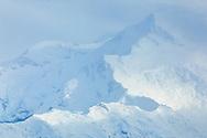 Close up of ridge on Mt. McKinley through thin clouds, Denali National Park & Preserve, Interior Alaska, Summer.