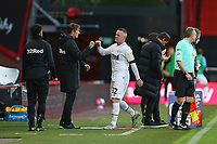 Football - 2020 / 2021 Sky Bet Championship - AFC Bournemouth vs. Derby County - The Vitality Stadium<br /> <br /> Wayne Rooney of Derby gets a fist bump from Derby County Manager Phillip Cocu after being subbed during the Championship match at the Vitality Stadium (Dean Court) Bournemouth <br /> <br /> COLORSPORT/SHAUN BOGGUST