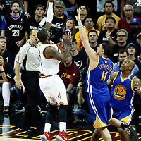 09 June 2017: Cleveland Cavaliers guard Kyrie Irving (2) goes for the layup past Golden State Warriors guard Klay Thompson (11) and Golden State Warriors forward David West (3) during the Cleveland Cavaliers 137-11 victory over the Golden State Warriors, in game 4 of the 2017 NBA Finals, at  the Quicken Loans Arena, Cleveland, Ohio, USA.