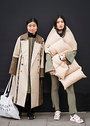 Nancy Peng and Tian Wang wearing Pinghe during London Fashion Week Autumn/Winter 2017 in London.  Picture date: Friday 17th February 2017. Photo credit should read: DavidJensen/EMPICS Entertainment