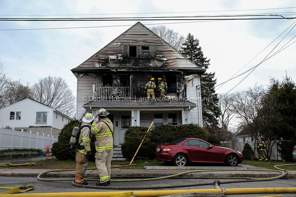 (4/21/20, MILFORD, MA) Firefighters work to extinguish a fire that broke out Tuesday morning at 9 Fruit St. in Milford. [Daily News and Wicked Local Photo/Dan Holmes]