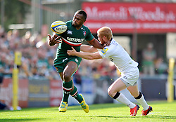Leicester Tigers winger Vereniki Goneva is tackled by Newcastle Falcons winger Tom Catterick - Photo mandatory by-line: Patrick Khachfe/JMP - Tel: Mobile: 07966 386802 - 21/09/2013 - SPORT - RUGBY UNION - Welford Road Stadium - Leicester Tigers v Newcastle Falcons - Aviva Premiership.