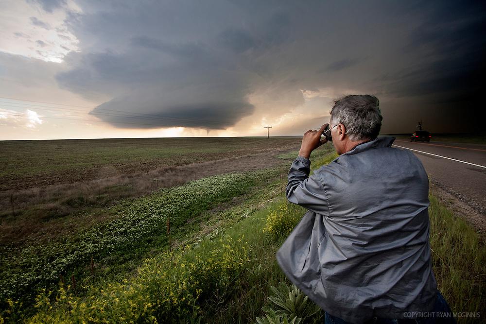 Storm scientist and engineer Tim Marshall photographs a tornado near Last Chance, Colorado, June 10, 2010.