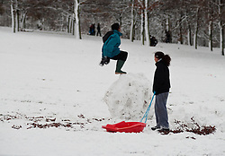 © under license to London News Pictures. 18/12/10.  A child does a backflip from a snowball. After heavy snowfall in London today (Sat), people take advantage of the snow in Greenwich Park. Credit should read Matt Cetti-Roberts/London News Pictures
