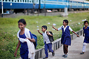 Pupils from a government-run school are walking back home through the impoverished New Arif Nagar colony, in Bhopal, Madhya Pradesh, India, near the abandoned Union Carbide (now DOW Chemical) industrial complex.