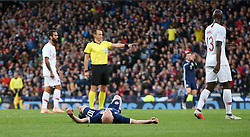Scotland's Steven Naismith lies on the pitch after a missed chance during the International Friendly match at Hampden Park, Glasgow.