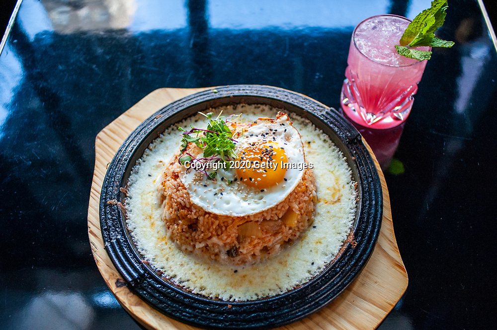NEW YORK- JANUARY 09: Volcano Kimchi Fried Rice with Booze Over Flowers photographed at Chef Esther Choi's My Soo on January 9th, 2020 in New York City. (Photo by Kris Connor/Getty Images for OK! Magazine)