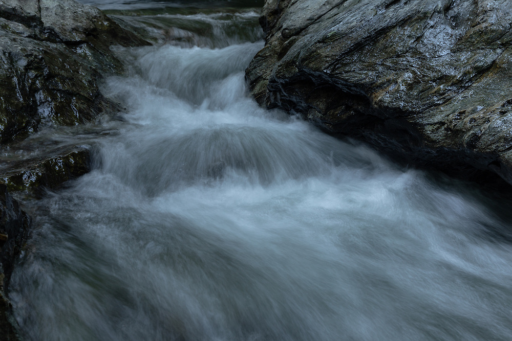 Cold mountain water roaring through the Waterbury River below the base of Bingham Falls.