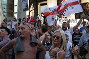 Free Tommy Robinson demonstrators shout slogans and wave flags at their opposition organised by anti-fascist groups including Stand up to Racism opposed to far right politics on 24th August 2019 in London, United Kingdom. Some 250 Stand Up To Racism and other anti-fascist groups took to the streets today in opposition to supporters of jailed 'Tommy Robinson' real name Stephen Yaxley-Lennon at Oxford Circus, who gathered outside the BBC.