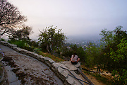 Observatory Visitor Sitting on a Rock Overlooking the City of LA