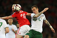 Glenn Whelan of Republic of Ireland ® jumps for a header with Jonathan Williams of Wales. Wales v Rep of Ireland , FIFA World Cup qualifier , European group D match at the Cardiff city Stadium in Cardiff , South Wales on Monday 9th October 2017. pic by Andrew Orchard, Andrew Orchard sports photography