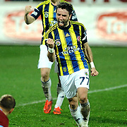 Fenerbahce's Gokhan Gonul (F) celebrate his goal during their Turkish SuperLeague Derby match Trabzonspor between Fenerbahce at the Avni Aker Stadium at Trabzon Turkey on Sunday, 17 February 2013. Photo by TURKPIX