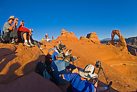 Masses of tourists flock daily to see the sunset on Delicate Arch, Arches National Park, Utah