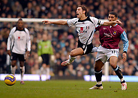 Photo: Alan Crowhurst.<br />Fulham v West Ham United. The Barclays Premiership. 23/12/2006. Fulham's Michael Brown (L) is fouled by Hayden Mullins.