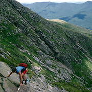 Hiker in the glacial cirque of Huntington Ravine, below Mt. Washington. The trail is one of the most challenging in the region.