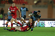 Willis Halaholo of Cardiff Blues ® is stopped byRhys Patchell of the Scarlets (on ground). . Guinness Pro14 rugby match, Scarlets v Cardiff Blues  at the Parc y Scarlets in Llanelli, West Wales on Saturday 28th October 2017.<br /> pic by  Andrew Orchard, Andrew Orchard sports photography.