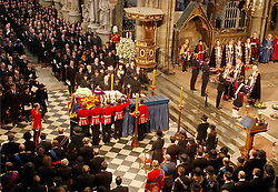 File photo dated 09/04/02 of the coffin of Queen Elizabeth the Queen Mother being placed on catafalque at Westminster Abbey. The Queen mother's funeral was the last royal funeral to be extensively televised in the UK. Issue date: Friday April 16, 2021.