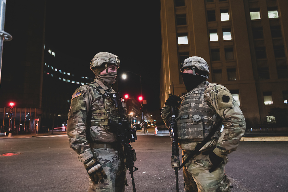 Washington DC, USA - January 19, 2021: Two members of the Pennsylvania National Guard stand on a street corner near L'Enfant Plaza, part of the 25,000 person deployment to secure the Biden Presidential Inauguration.