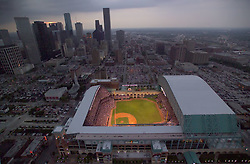 Aerial view of Minute Maid Park with an open roof in downtown Houston, Texas at dusk.