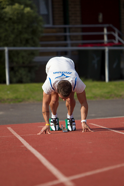 Melbourne, Australia, 27th July 2010: 22 year old Australian 100m sprinter Aaron Rouge-Serret trains at Essendon Athletic Track in preparation for representing Australia in the upcoming Commonwealth Games in India..Photo: Joseph Feil