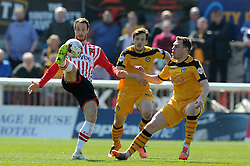 Exeter City's Ryan Harley is tackled by Newport County's Adam Chapman - Photo mandatory by-line: Harry Trump/JMP - Mobile: 07966 386802 - 06/04/15 - SPORT - FOOTBALL - Sky Bet League Two - Exeter City v Newport County - St James Park, Exeter, England.