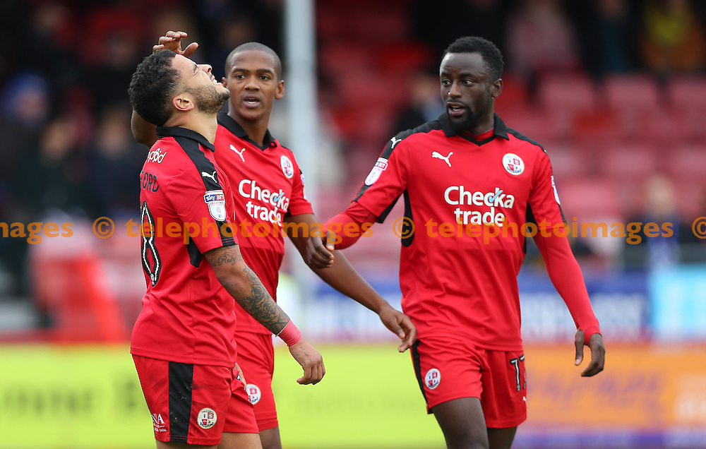 Crawley's Billy Clifford celebrates after scoring with Lewis Young and Bobson Bawling during the FA Cup match between Crawley Town and Bristol Rovers at the Checkatrade Stadium in Crawley. November 5, 2016.<br /> James Boardman / Telephoto Images<br /> +44 7967 642437