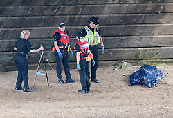 © Licensed to London News Pictures. 10/07/2016. <br /> Police officers stand next to what appears to be a body covered in a plastic sheet, nor where  a man was seen falling from a bridge into the River Ouse in York on Sunday 10th July 2016 . Photo credit: Max Bryan/LNP