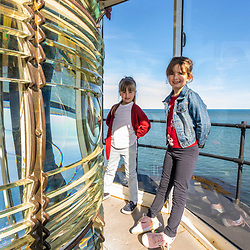 Two young girls in the West Quoddy Head Lighthouse in Lubec, Maine. Easternmost point in the United States.