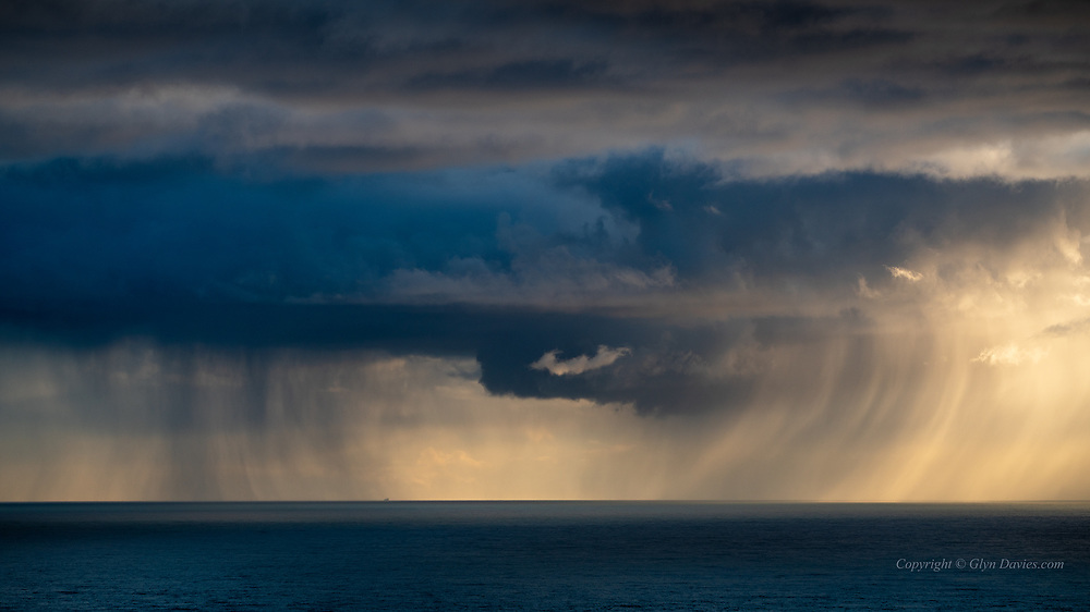 Half an hour of amazing swirling cloud, showers and atmospheric drama last night over the Irish Sea from South Stack. I make a point of avoiding photographing the lighthouse, but I do love the sea from here. Actually the wonderfully curved curtains of rain only lasted a few minutes before becoming more regular sheets of rain.