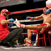 KISSIMMEE, FL - MARCH 05:   Cornerman Ray Beltran tapes the soles of Jesus Alberto Beltran after he started to slip in the ring against Yomar Alamo during the Boxeo Telemundo All Star Boxing event at Osceola Heritage Park on March 5, 2021 in Kissimmee, Florida. (Photo by Alex Menendez/Getty Images) *** Local Caption *** Yomar Alamo; Jesus Alberto Beltran; Ray Beltran