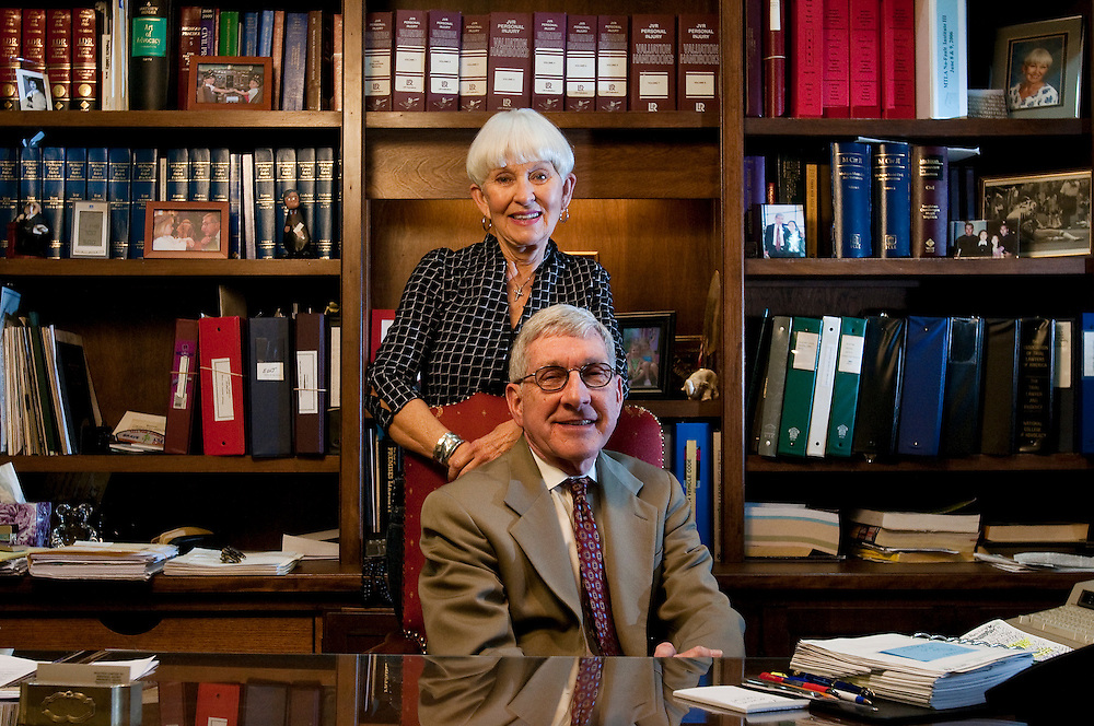 Matt Dixon | The Flint Journal..Ed and Suzanne Jakeway pose for a portrait in Ed's law office in Grand Blanc Tuesday afternoon. The couple was recently recognized by Eastern Michigan University with the Presidential Award for Advancing Philanthropy for their generous gifts and volunteerism over the past 20 years.