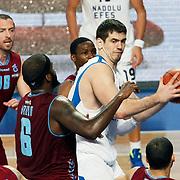 Anadolu Efes's Stanko Barac (R) during their Turkish Basketball League match Anadolu Efes between Trabzonspor at Sinan Erdem Arena in Istanbul, Turkey, Saturday, December 10, 2011. Photo by TURKPIX