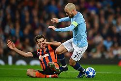 Shakhtar Donetsk''s Taras Stepanenko (left) fouls Manchester City's David Silva and concedes a penalty