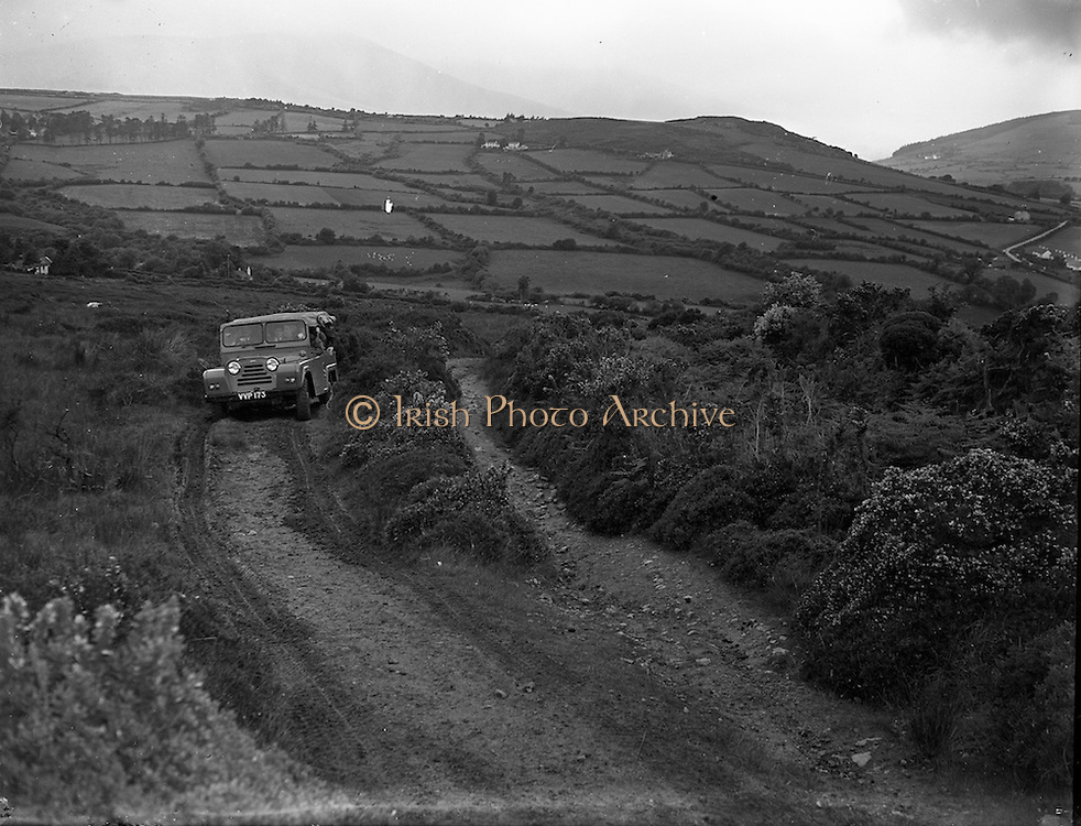 19/06/1958<br /> 06/19/1958<br /> 19 June 1958<br /> Austin Gipsy off road vehicle demonstration to the army at Kilmacanogue, Co. Wicklow.