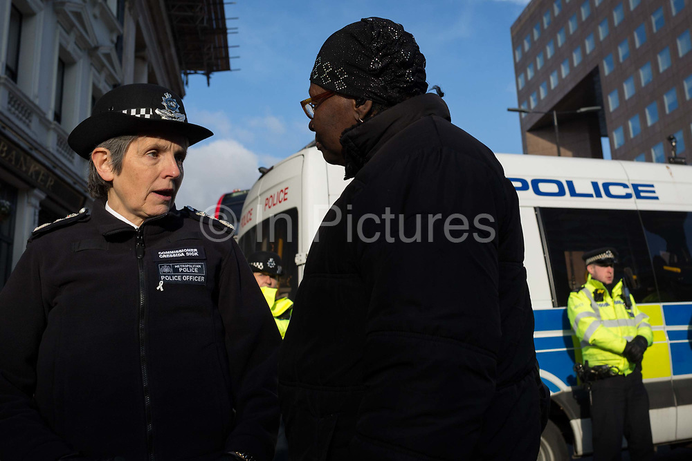 The morning after the terrorist attack at Fishmongers Hall on London Bridge, in which Usman Khan a convicted, freed terrorist killed 2 during a knife a attack, then subsequently tackled by passers-by and shot by armed police - Met Police Commissioner Cressida Dick speaks with a local lady before touring Borough Market, on 30th November 2019, in London, England.