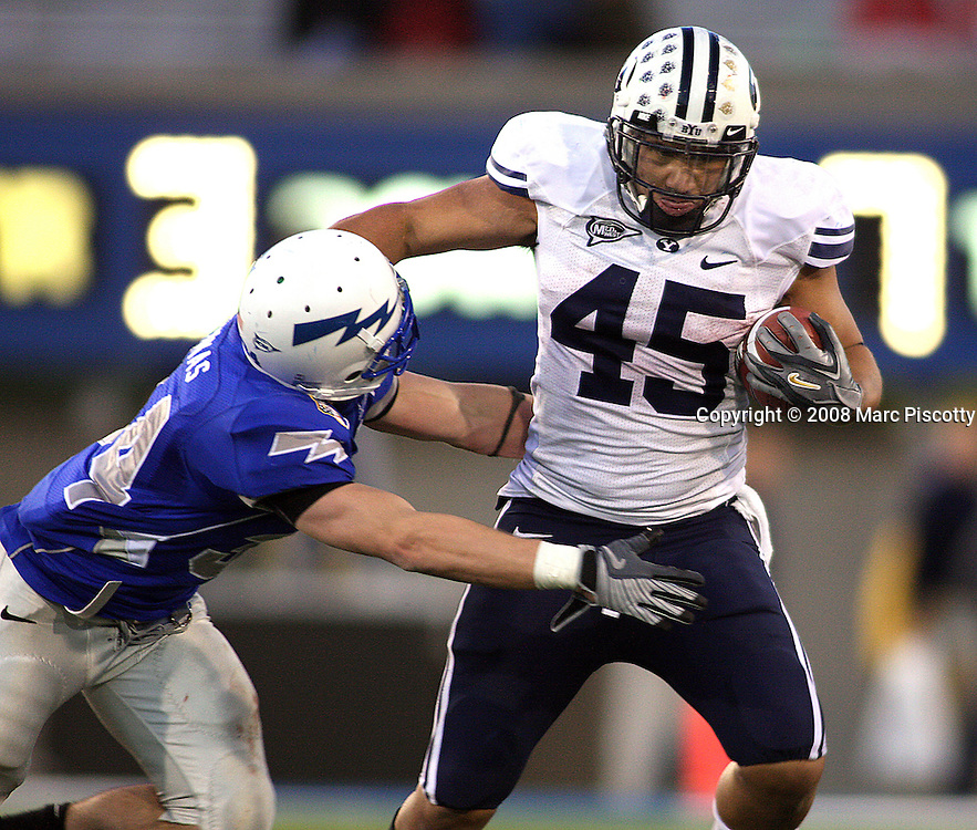 SHOT 11/15/08 5:46:50 PM - Air Force's Chris Thomas (#34, SS) tries to bring down BYU's Harvey Unga (#45, RB) during the second half of their game Saturday November 15, 2008 at Falcon Stadium on the Air Force Academy in Colorado Springs, Co. Brigham Young won the game 38-24. Thomas had 17 tackles in the game, two for losses..(Photo by Marc Piscotty / © 2008)