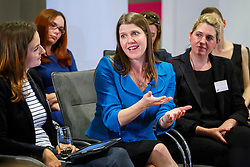 © Licensed to London News Pictures. 30/06/2014. LONDON, UK. Jo Swinson answers a question whilst the Deputy Prime Minister, Nick Clegg holds a Q&A session with mums, dads and grandparents with Mumsnet and Gransnet at PwC in central London on Monday, 30 June to mark the first day that all employees gain the right to request flexible working from their employers. Photo credit : Tolga Akmen/LNP