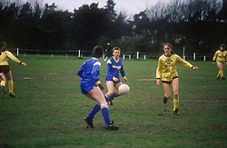 Women's football team playing in match,