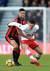 Southampton's Dusan Tadic (right) and AFC Bournemouth's Andrew Surman battle for the ball during the Premier League match at the Vitality Stadium, Bournemouth.