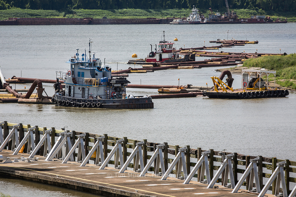 Dredge boats clear the entrance to the Port Allen Lock. Low water levels from the severe drought across the U.S. makes shipping increasingly difficult on the Mississippi River.