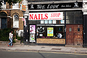 The Look hair salon and Nail Bar shop on Camberwell Road in South London. This is a a multicultural area in South London where different people of all nationalities and races mix together.