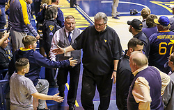 Dec 1, 2019; Morgantown, WV, USA; West Virginia Mountaineers head coach Bob Huggins celebrates with fans after beating the Rhode Island Rams at WVU Coliseum. Mandatory Credit: Ben Queen-USA TODAY Sports