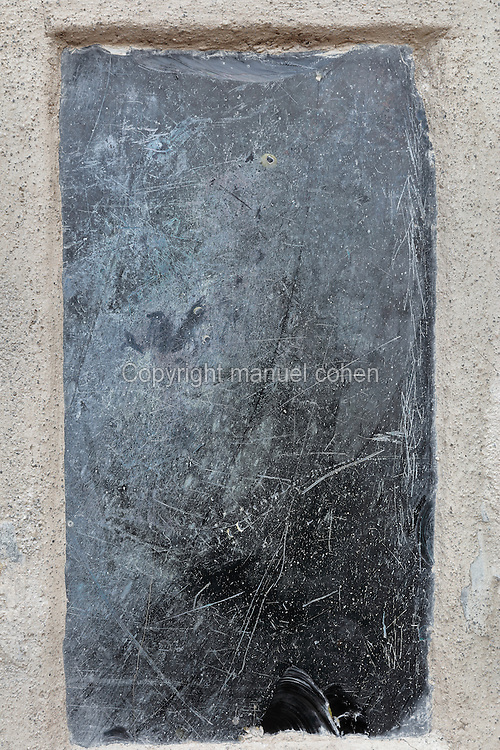 Black volcanic stone, possibly polished for use as a mirror or used for spiritual or religious purposes, from the atrium of the Casa dell Efebo, or House of the Ephebus, Pompeii, Italy. This is a large, sumptuously decorated house probably owned by a rich family, and named after the statue of the Ephebus found here. Pompeii is a Roman town which was destroyed and buried under 4-6 m of volcanic ash in the eruption of Mount Vesuvius in 79 AD. Buildings and artefacts were preserved in the ash and have been excavated and restored. Pompeii is listed as a UNESCO World Heritage Site. Picture by Manuel Cohen