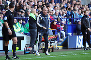 Brentford Manager Mark Warburton gives instructions from pitch side. Skybet football league championship match, Bolton Wanderers v Brentford at the Macron stadium in Bolton, Lancs on Saturday 25th October 2014.<br /> pic by Chris Stading, Andrew Orchard sports photography.