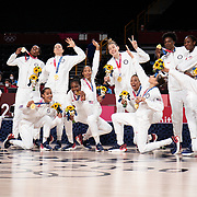 TOKYO, JAPAN August 8:  The United States Women's basketball team in victory pose after the gold medal presentation after the Japan V USA basket final for women at the Saitama Super Arena during the Tokyo 2020 Summer Olympic Games on August 8, 2021 in Tokyo, Japan. (Photo by Tim Clayton/Corbis via Getty Images)